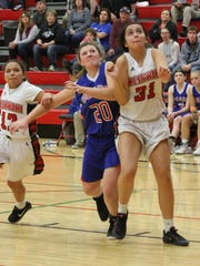BGM's Kelsey Lint, 20, and Meskwaki Settlement School's Tori Lasley, 31, and Marley Whitefish, 12, eye a possible rebound during BGM's 47-42 Class 1A - Region 7 win at Meskwaki on Thursday, Feb. 9.