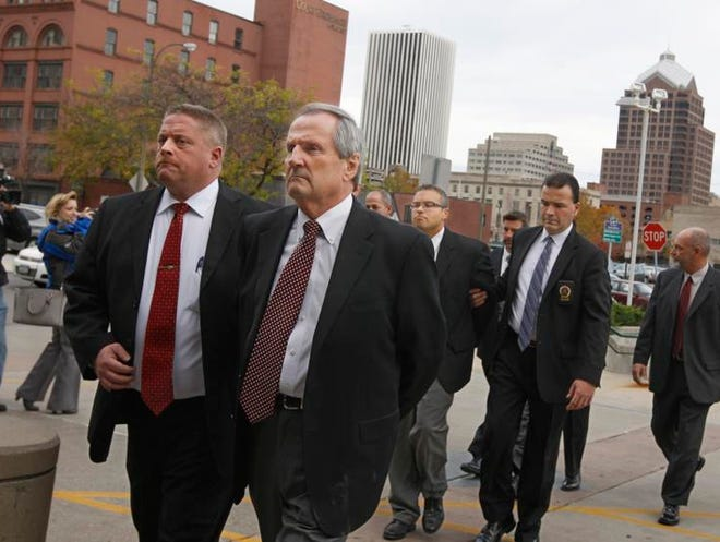 Robert Wiesner, front right, husband of Monroe County Executive Maggie Brooks and former Monroe County Water Authority security director, is one of four escorted from the Attorney General's office to the Rochester Police Department for booking as part of the LDC scandal investigation Wednesday.