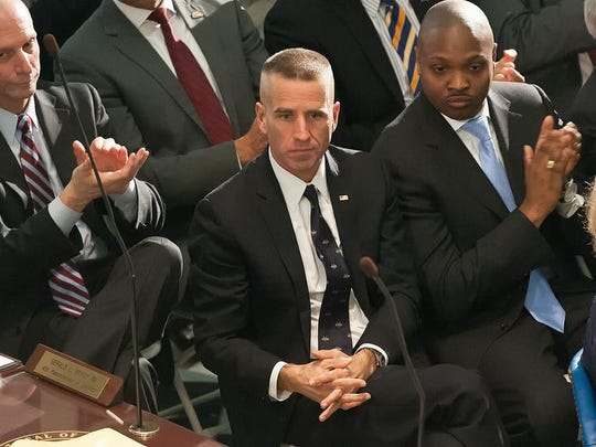 Delaware Attorney General Beau Biden (left) and State Treasurer Chip Flowers at Gov. Jack Markell's State of the State address Jan. 23 in Dover.
