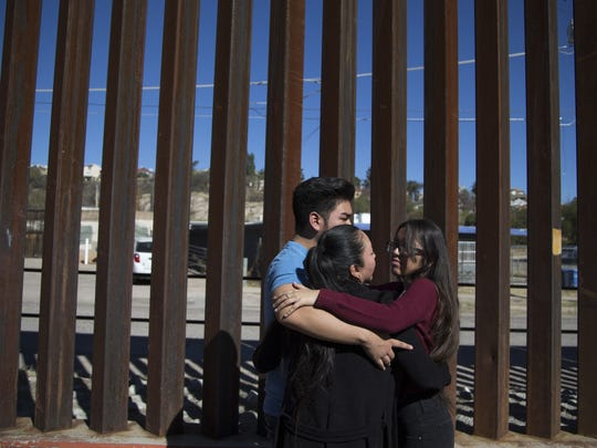 The family of Guadalupe Garcia de Rayos  hugs while