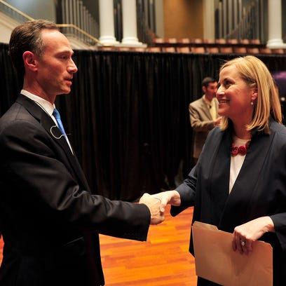 Megan Barry shakes hands with David Fox after a runoff