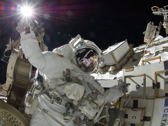 Astronaut Sunita Williams, appears to touch the sun during a spacewalk. A president's outlook on innovation, world leadership and federal budgets always impacts NASA and its missions.