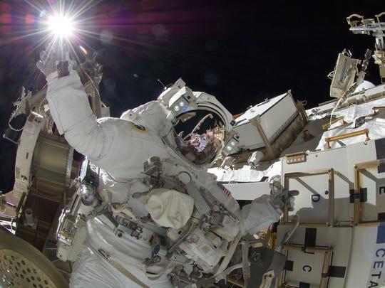 Astronaut Sunita Williams, appears to touch the sun