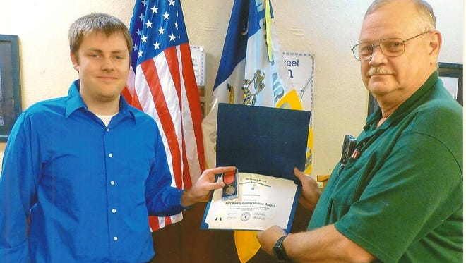 Nick Hamilton (left), Secretary of the Arthur St. Clair Chapter Ohio Society Sons of the American Revolution, presents Steven Fields with the Fire Safety Award.