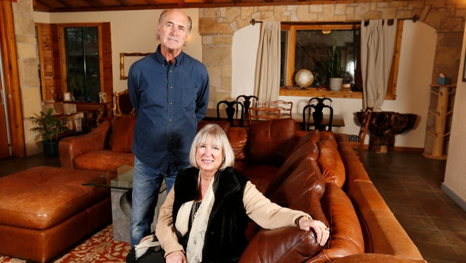 Owner Rick Heggen (left) and property manager Hele Spivack sit in the great room of the short-term rental property they call Beaverdale Lodge Tuesday, Dec. 1, 2015 in Des Moines. Heggen and Spivack rented out the place on the Vacation Rental by Owner website, but disputes with neighbors and restrictions from the city have halted their efforts.