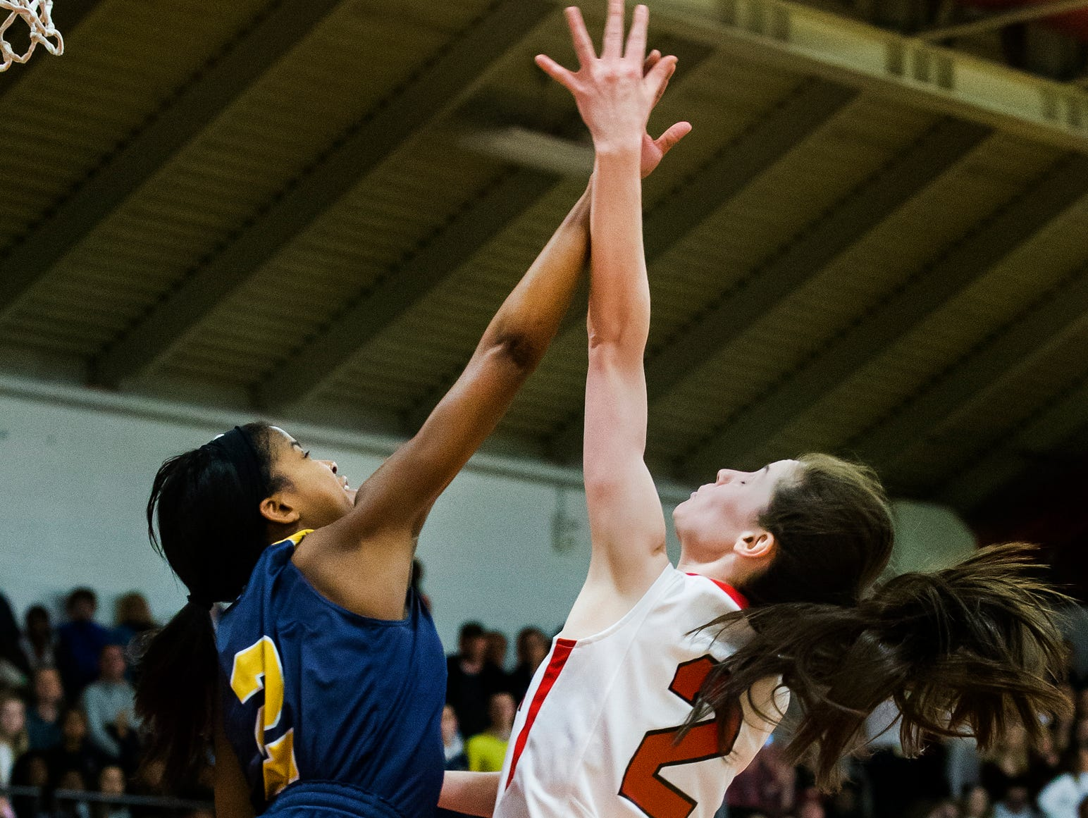 Ursuline's Maggie Connolly (right) is fouled as she puts up a shot over Sanford's Lauren Park (left) in the second half of Ursuline's 50-40 win over Sanford at Ursuline Academy on Thursday night.