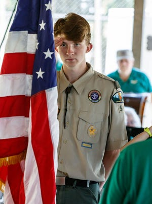 Christian Eddy of Boy Scout Troop 54 salutes the flag as the Palmyra-Eagle Community Band plays the national anthem at Eagle Village Park on Sunday, July 8. On Aug. 10-11, Oconomowoc scout troops will host a family campout at Roosevelt Park.