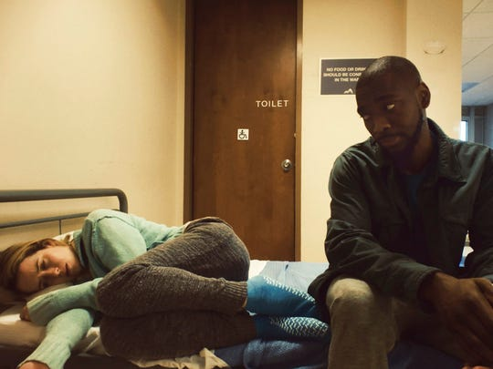 "Claire Foy, left, and Jay Pharoah in ""Unsane."""