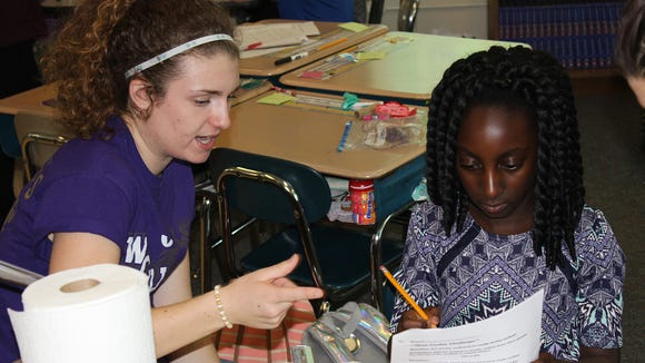 Marie D'Amanda helps Angel convert diameter to radius to calculate volume. (J. Baier)