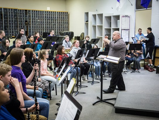 The Spirit of Muncie band members work on proper playing