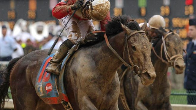 Jockey Joel Rosario, left, pops his whip as he rode Orb to win the 2013 Kentucky Derby at Churchill Downs last May.