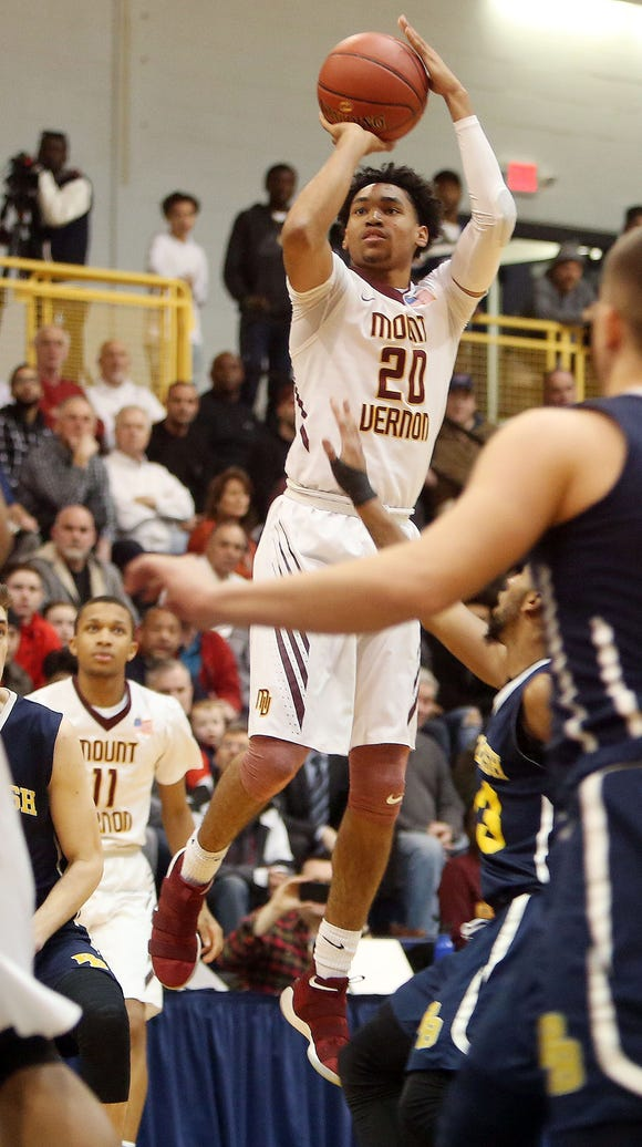 Mount Vernon's Jason Douglas-Stanly (20) puts up a