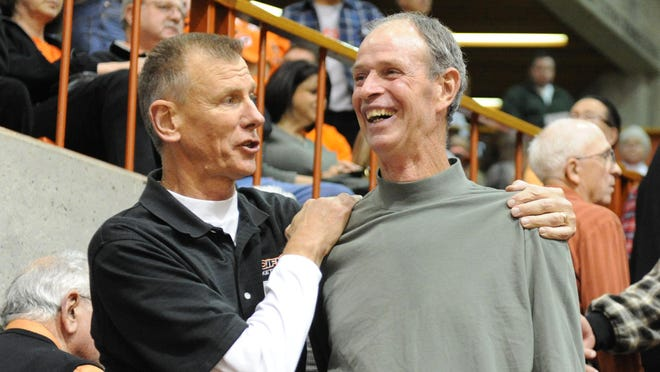 University of the Pacific basketball star Bill Stricker, left, and former teammate John Gianelli share a moment at a Tigers' game in 2011. Stricker passed away Friday at the age of 72.