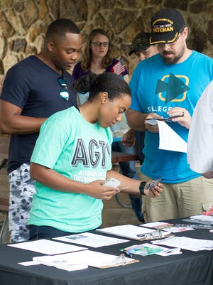 Jasmin Luck, a U.S. Air Force chaplain candidate and AGTS student, explores information displayed at a picnic hosted by Evangel University last summer for veterans at EU, AGTS, Drury, MSU and OTC.