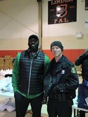 New York Jets football player Muhammad Wilkerson, a Linden High School graduate, and Linden Officer Daniel Kuczynski