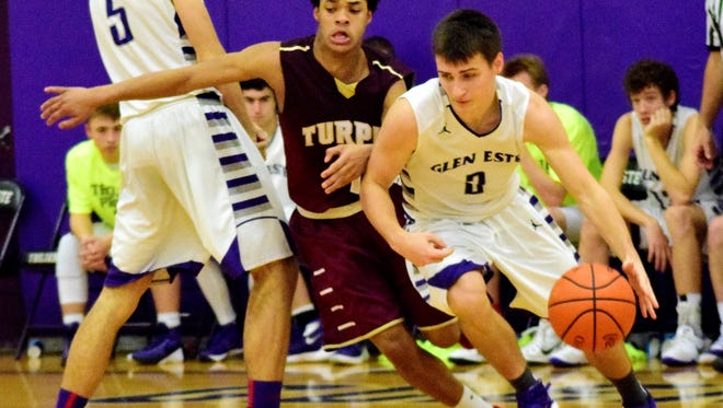 Glen Este's Colin Fryman uses his pick and moves past Turpin's A'Drien Baker.  December 11, 2015.