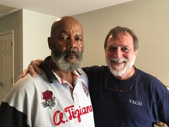 Clarke Banta (right), executive director of Valley supportive housing, poses for a photo with Charles Scott, at Scott's Staunton apartment that he rents through the program on Tuesday, April 11, 2017.