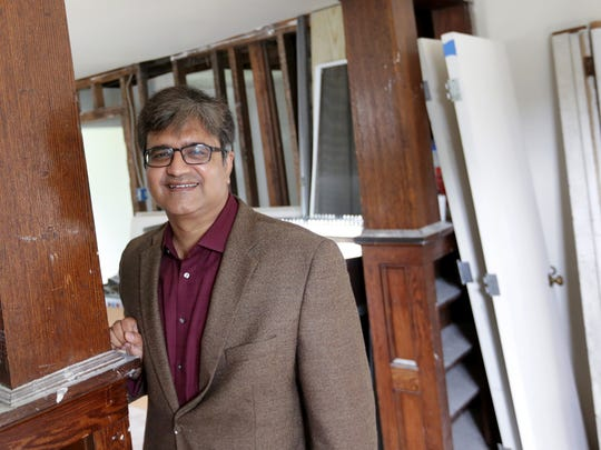 Waseem Ullah, MD founder and co chairman DREAM of Detroit, in one of the homes they are fixing up on Waverly Street in Detroit on Friday, June 19, 2015.