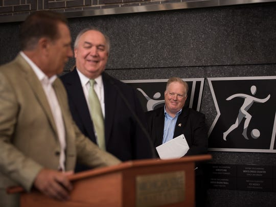 Bill Beekman, right, smiles Monday as MSU basketball coach Tom Izzo speaks at a news conference naming Beekman as MSU's new athletic director.