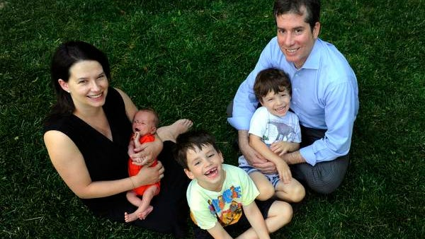 Shana and Jon Dowell with their sons Benjamin 2 weeks, Noah 6, and Simon 3, at their home in Nashville, Tenn.