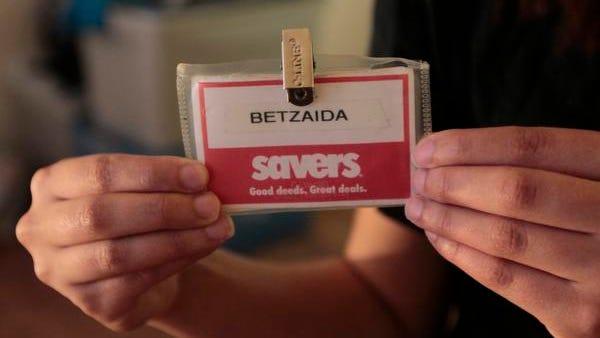 Betzaida Cruz Cardona still has her Savers employee ID badge in her Fairport apartment.