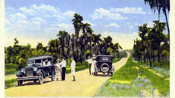 1920s color postcard of the Dixie Highway in Florida.