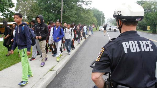Students from Spring Valley High School, members of the East Ramapo Student Coalition, walk out of the school to protest budget cuts in May 2013.