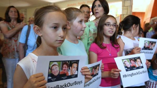 Children hold up #BringBackOurBoys signs at the Rockland Jewish Community Campus in West Nyack June 18, 2014. The Jewish Federation of Rockland County, JCC Rockland and The Rockland County Board of Rabbis lead the community in psalms for the safe return of Eyal Yifrah, Gilad Shaar and Naftali Frenkel, the three Israeli teens who were kidnapped by terrorists on June 12.