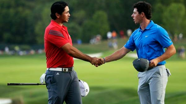 Jason Day, left, and Rory McIlroy shake hands on the 18th green following the third round of the PGA Championship at Valhalla Golf Club in Louisville, Ky., on Saturday.