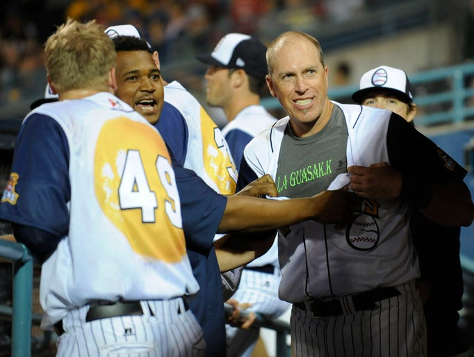 The Toledo Mud Hens' Mike Hessman shows off his undershirt,