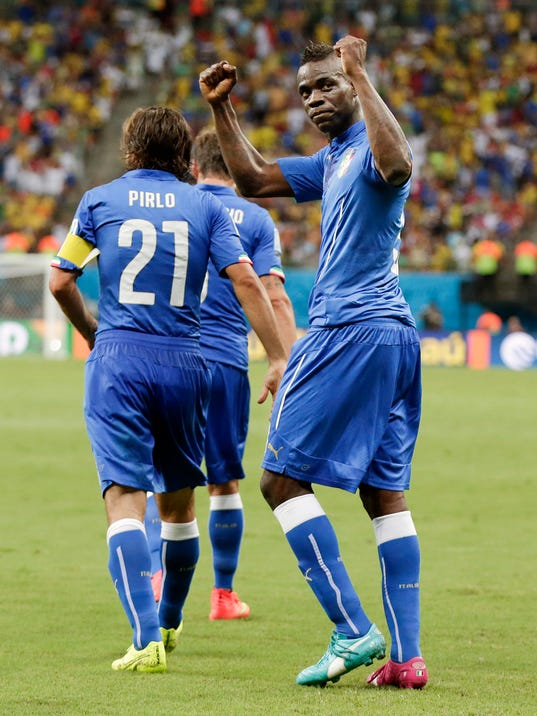 Italy's Mario Balotelli, right, gestures to the crowd after scoring his side's second goal during the group D World Cup soccer match between England and Italy at the Arena da Amazonia in Manaus, Brazil, Saturday, June 14, 2014.(AP Photo/Marcio Jose Sanchez)