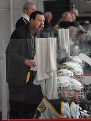 St. Norbert College men's hockey coach Tim Coghlin,