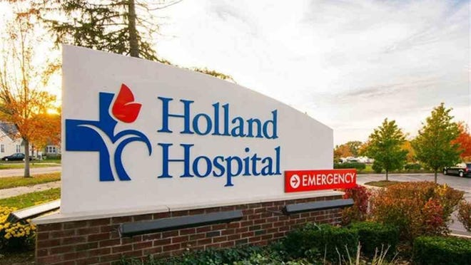 Holland Hospital reinstated restrictions on visitors as COVID-19 cases rise in Ottawa County and health officials worry about the impact of the start of flu season.
