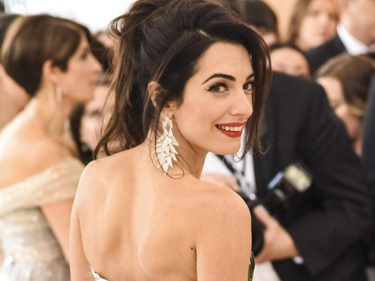 "Amal Clooney attends the ""Heavenly Bodies: Fashion"