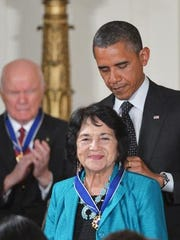 Dolores Huerta receives the Presidential Medal of Freedom from President Obama at the White House in 2012.