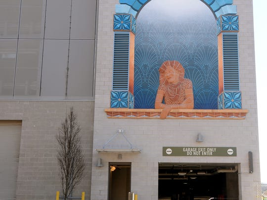 The Daydreamer mural located on the exit of the parking