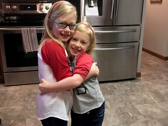 "Claire Ambrose, left, and her sister Chloe, on ""Go Red Day."""
