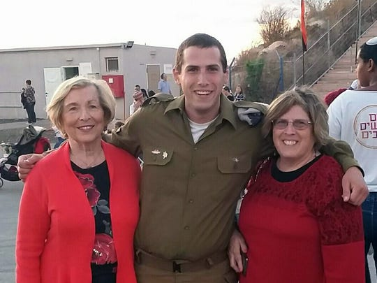 Sgt. Adam Kwestel of the Israel Defense Forces stands with grandmother Rachel Lipsitz (left) and his mother Robin Kwestel after a ceremony marking the completion of a course, where he received his commander pin.