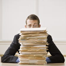 """The """"mountain of work"""" piling up on their desks was the reason that 40 percent of workers said they had difficulty taking time off."""