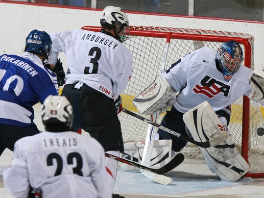 FILE - In this Nov. 8, 2008, file photo, United States' goalie Brandon Maxwell catches the puck as Tyler Amburgey (3) moves in to defend against Finland's Joonas Hurri (3) while United States' A.J. Treais (23) watches the play during the under 18 men's Four Nations Cup Hockey Tournament Championship game in Lake Placid, N.Y. USA Hockey named David Leggio and Brandon Maxwell as the final two goaltenders for its Olympic team. U.S. general manager Jim Johannson on Thursday, Jan. 11, 2018, announced the final two players on the 25-man roster. (AP Photo/Todd Bissonette, File)