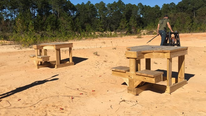 Tables used for target shooting at the property on Longleaf Drive.