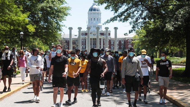 Missouri athletes and coaches walk from the Francis Quadrangle toward downtown Columbia on Wednesday during a march against racial injustice and the death of George Floyd.