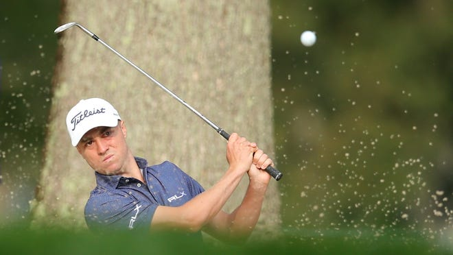 Justin Thomas hits out of a sand trap onto the 3rd green during the first round of the U.S. Open Thursday at Winged Foot Golf Club in Mamaroneck, N.Y.