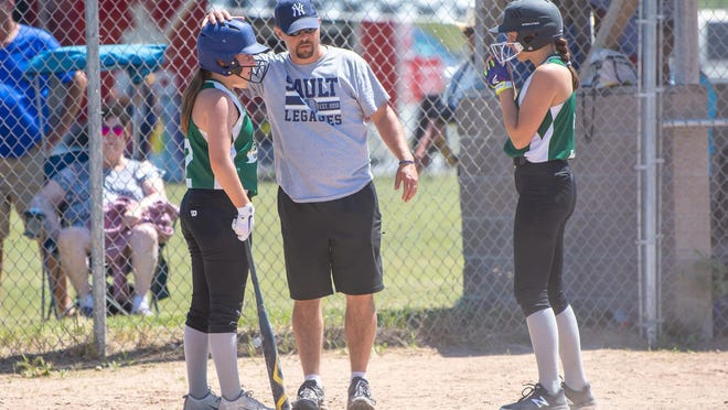 Matt Hudecek, center talks to players with the Soo Legacies during a tournament this past summer. Hudecek is the new coach for Pickford softball.