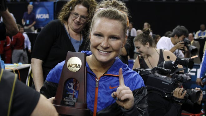 Florida's Bridget Sloan gestures after winning all-around gymnast in the NCAA college women's gymnastics individual championship at UCLA in Los Angeles in 2013.