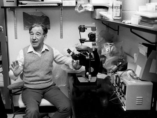Vanderbilt University biochemist Stanley Cohen talks about solving mysteries of cell growth to the media in his fifth floor laboratory at the Vanderbilt University Medical Center Oct. 13, 1986. Cohen, a Nobel Prize winner in medicine, died Wednesday in Nashville.