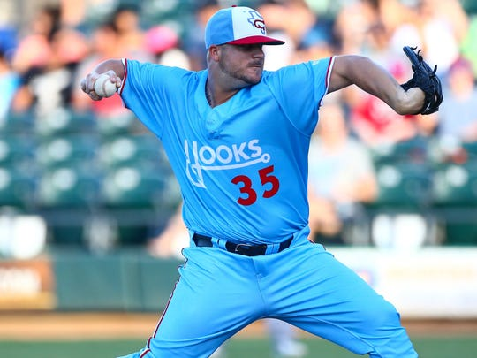 "Hooks' Keegan Yuhl wears the Hooks ""FauxBack"" uniform last year. The promotion was so popular the uniforms will be the Hooks alternate jerseys this season and will be worn every Friday."