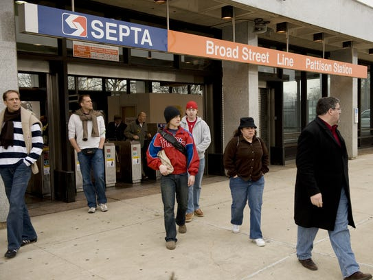 People exit the SEPTA Broad Street Line Pattison Station