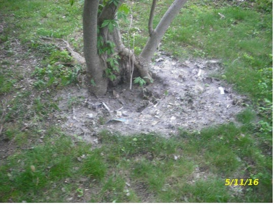 "The Delaware Department of Justice included this photograph of raw sewage in the backyard of a home on Hessler Lane in a 2016 complaint filed against Russell ""Scott"" Walker. The DOJ is claimed Walker and his foundation were housing about 150 tenants in overcrowded and deplorable conditions in violation of city, county and state code."
