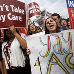 Supporters of the Affordable Care Act react with cheers after a U.S. Supreme Court ruling on June 25 upheld the law.